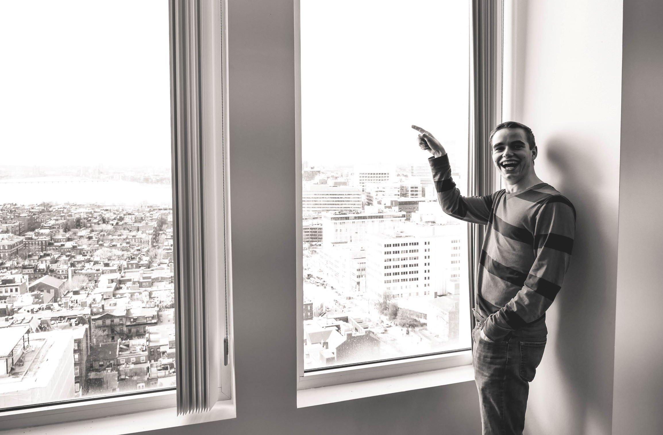 Young man points out window to possibilities